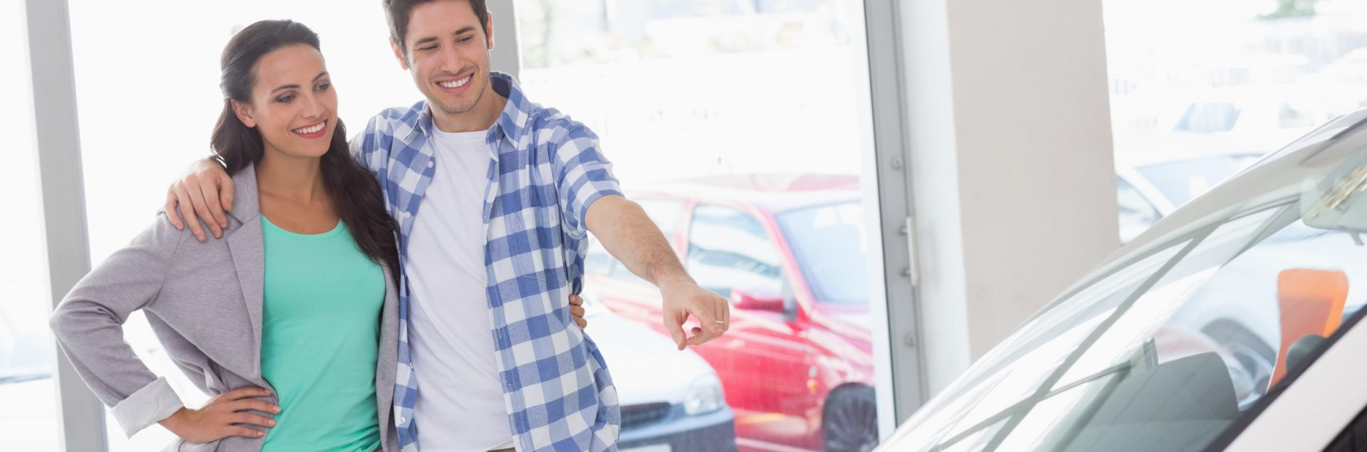 Image Of A Young Couple Who Came To the Car Yard To Choose A Car