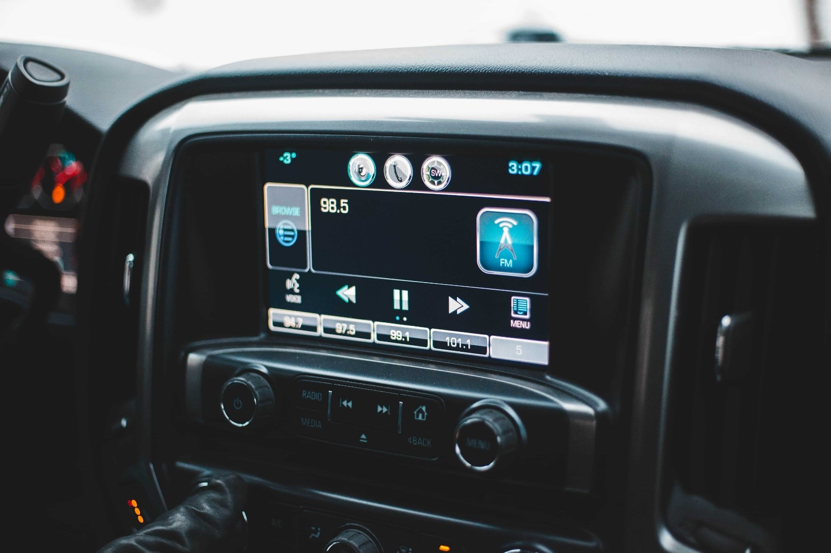 A close-up shot of a car's stereo and navigation system.