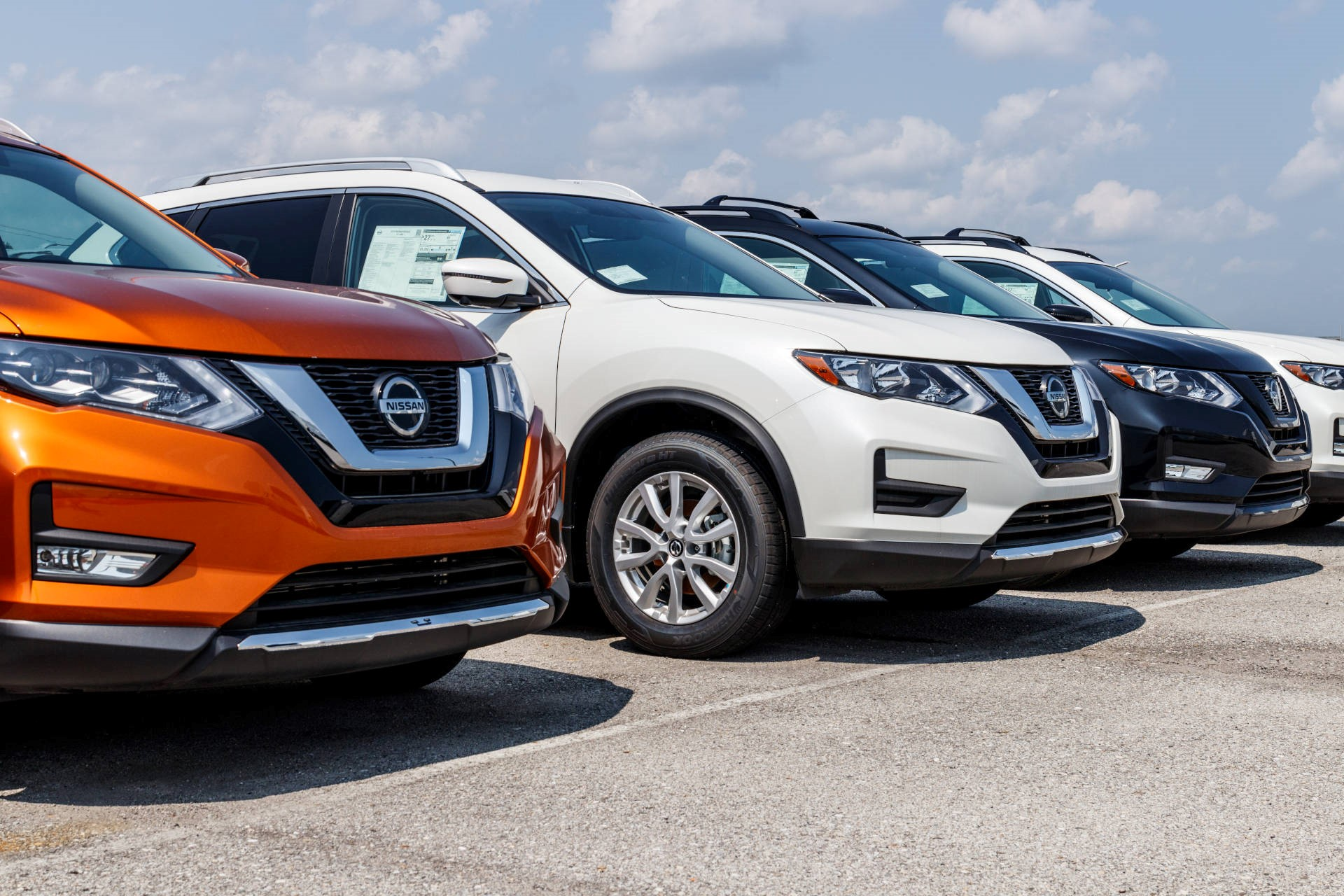 Line-up of Nissan used cars at a used car lot