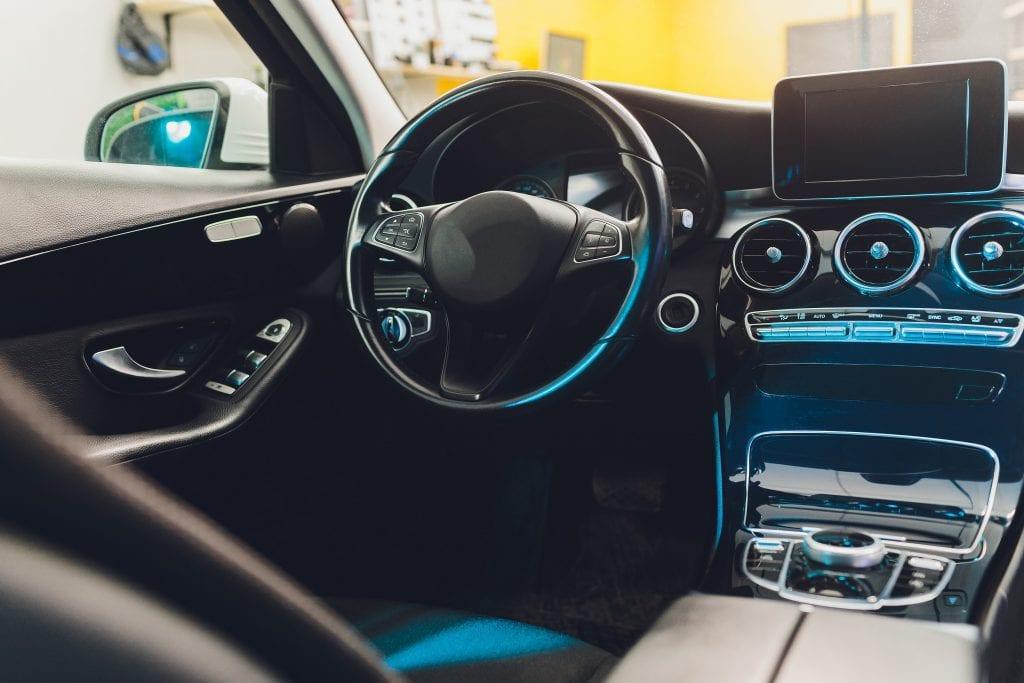 Dark luxury car interior, Steering Wheel, Shift Lever and Dashboard.
