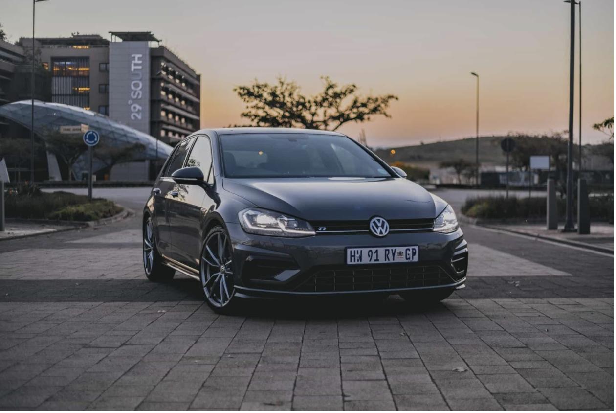VW golf sitting on cobblestone driveway