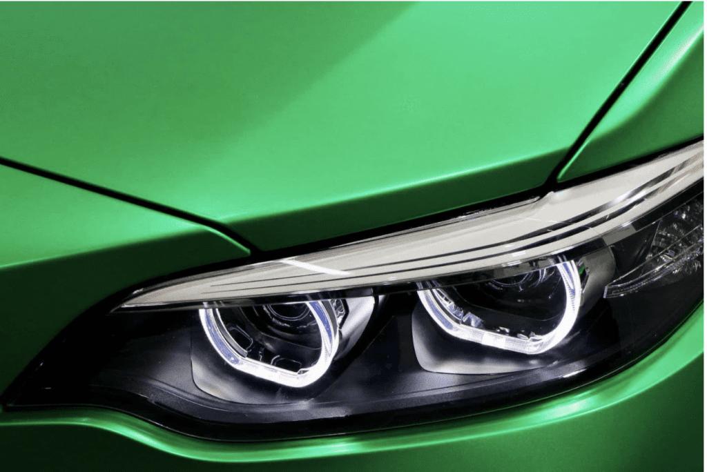 Close up on green car's headlight