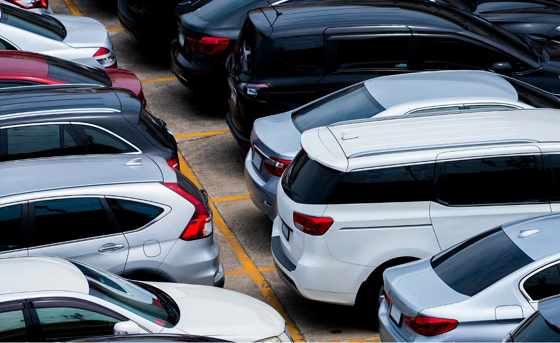 Used cars parked in carpark at dealership